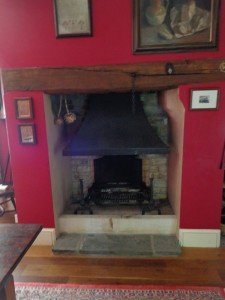 A open grate fireplace with hood