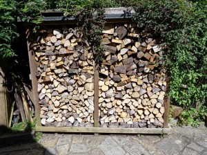 A well built fire wood shed basking in the sun