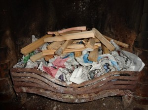 Newspaper with kindling on top