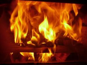 burning kindling igniting lower logs