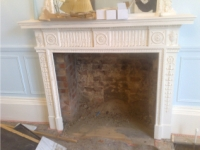 A fireplace with chamber exposed