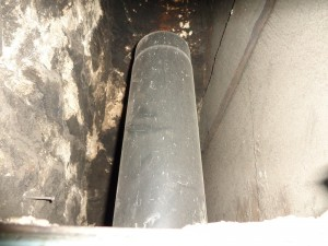 flue pipe adjacent to combustible fire surround