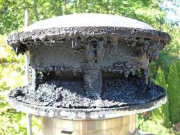 A chimney cowl choked with tar