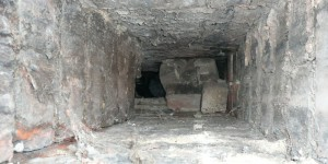 View down chimney showing loose bricks blocking it.