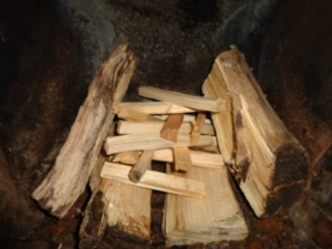 logs and kindling on top