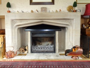 jetmaster tastefully inserted in stone fire place